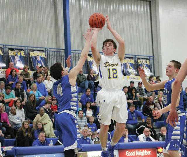 Olentangy's Sean Marks (12) fires a jumper during a game against rival Olentangy Liberty last season.