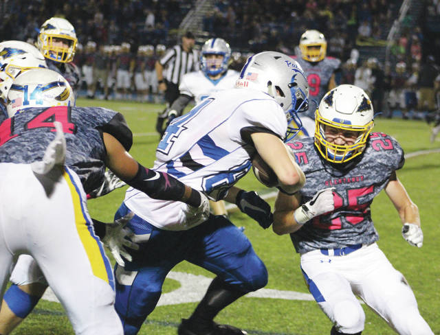 Olentangy's Conor Sherry (25) tackles Liberty's Jacob Sincek during a game earlier this season.