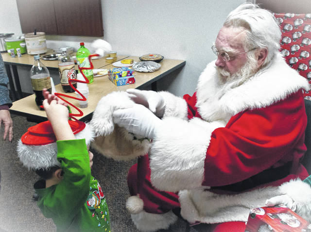 During the MOMS Christmas dinner and party, Santa Claus offered to trade hats with 3-year-old Akaidus Trejo. Trejo wasn't sure what to think, but he made the trade anyway with the Jolly Old Elf.