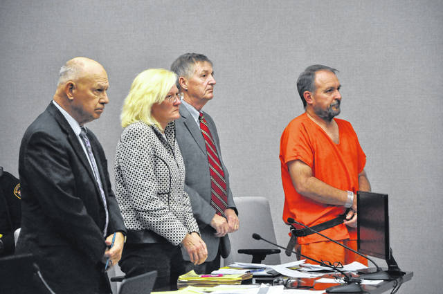 Arminda Martin, second from left, and her husband Theodore Martin, right, await their sentence Friday afternoon in Delaware County Common Pleas Court. Attorney Kingston Malley Jr., left, represented Arminda Martin and attorney William Leber, second from right, represented Theodore Martin during the case.