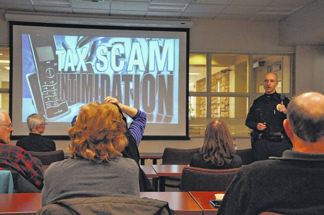 City of Delaware Police Department Patrol Officer Robert Hatcher gives a presentation about scammers Wednesday afternoon at SourcePoint. He said residents can research scams at the Federal Trade Commission's website, ftc.gov/scams, and said residents could sign up for free scam alerts.