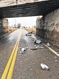 Debris was left in the roadway after a tractor trailer struck a railroad bridge on State Route 521.