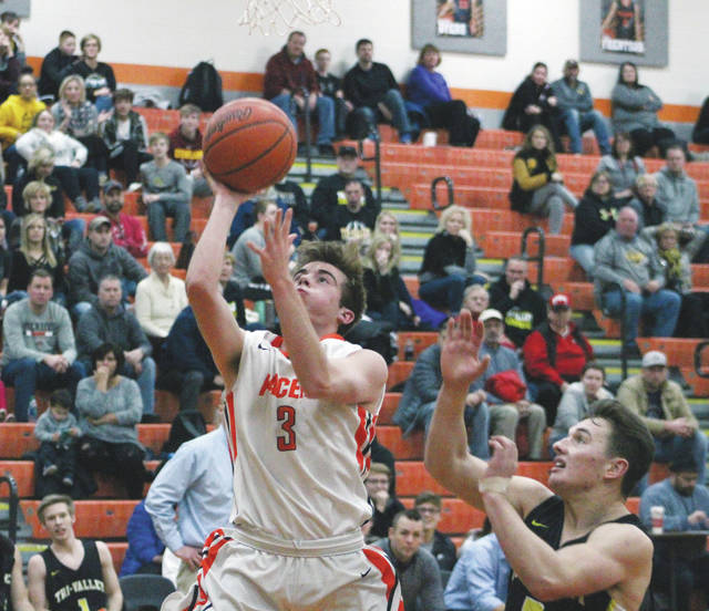 Hayes' Addison Harvey (3) soars in for a layup during the first half of Wednesday's showdown against visiting Tri-Valley.