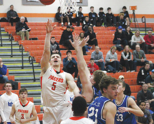 Hayes' Terin Kinsway (5) puts up a shot during the first half of Tuesday's non-league showdown against visiting Hilliard Davidson.