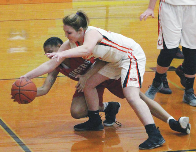 Hayes' Madison Eldridge, front, and Groveport's Melia Walder battle for possession during the first half of Thursday's non-league showdown in Delaware.