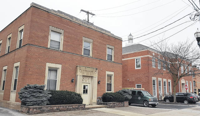 A lease agreement between the City of Delaware and a Worthington-based co-working space provider involving the City Hall Annex building (former Delaware Gazette building), left, is expected to be voted on by City Council on Feb. 12. The city has expressed plans to construct a connector bridge from the second story of the City Hall Annex, 18 E. William St., to City Hall, right, allowing city employees to utilize both facilities.