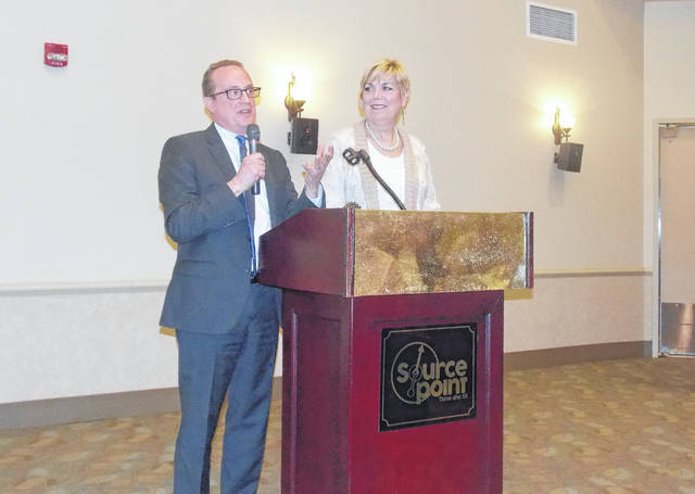 """Delaware City Manager R. Thomas Homan, left, addresses the crowd that turned out at SourcePoint on Thursday to hear Homan and Mayor Carolyn Kay Riggle, right, give the annual """"State of the City"""" presentation."""