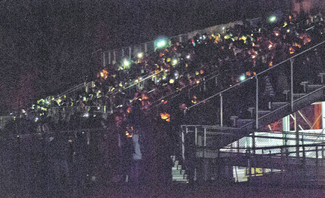 Classmates, family, and friends of Buckeye Valley High School students Jacob Richardson and Mykaela Fellure filled the football bleachers Thursday for a candlelight vigil. After the field lights were lowered, candles and cellphone lights were lit, and a prayer was said. Students came together to mourn the loss of their fellow students who died in a tragic car crash Wednesday afternoon.