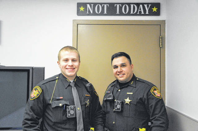 Delaware County Sheriff's Deputies Josh Bender, left, and Steve Ridenour, right, saved a man's life when they discovered his vehicle off the road on New Year's Eve. Troopers believe Lebanon resident Roscoe H. Brown Jr. swerved on the road to miss a deer while driving along State Route 61 in Berkshire Township and crashed his SUV on Dec. 31. He is still hospitalized.