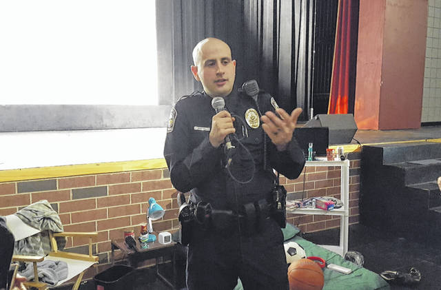"After using a mock bedroom setup to show parents where kids are most likely to hide drugs, Powell Police Officer Ben Boruchowitz took questions from some of the more than 120 parents who turned out for the ""Hidden in Plain Sight"" drug awareness seminar held Thursday at Olentangy Liberty High School in Powell."