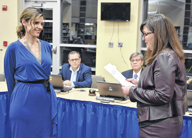 Olentangy Local Schools Board of Education member Mindy Patrick, left, is sworn in as president by Treasurer Emily Hatfield during the board's annual organizational meeting held Jan. 11 at Liberty High School.