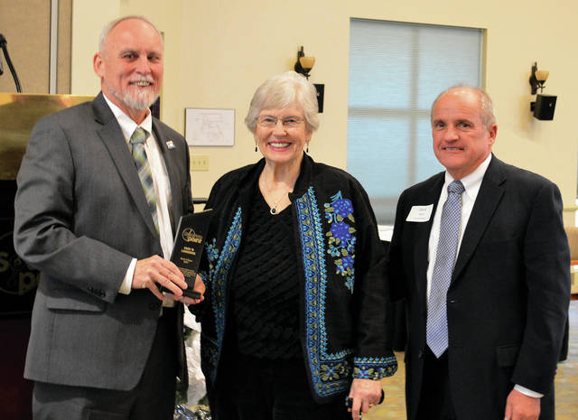 The Rock of Ages honor is given each year to those who have provided long-standing support to SourcePoint. This year's two recipients, Joan W. Lawrence and the Franklin Foundation, Inc. were recognized at the organization's Impact Lunch Dec. 20. Pictured from left are SourcePoint Executive Director Robert Horrocks, honoree Joan W. Lawrence, and SourcePoint Board of Directors President David Black.