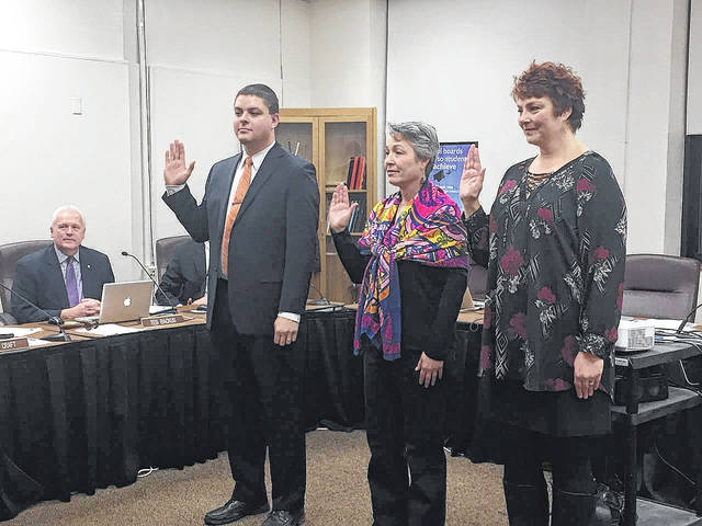Delaware City Schools board of education members Michael Wiener, Frances O'Flaherty, and Jayna McDaniel-Browning are sworn in Monday evening during the board of education's organizational board meeting.