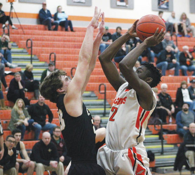Hayes' Jwan Lyles (2) hangs in the air before cashing in on a short jumper during the first half of Tuesday's OCC showdown against visiting Dublin Jerome.
