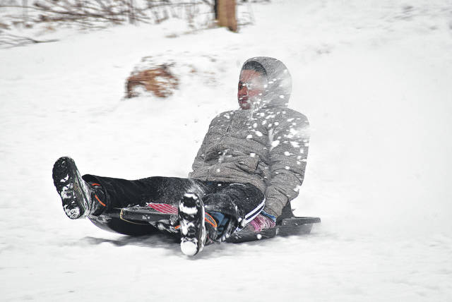 Since all the schools in Delaware County declared Wednesday a snow day and closed, students didn't let the day go to waste. The sledding hill at Gallant Woods Park brought smiles, laughter, and some snow to the faces of the children like Chaz Sakala. He caught a face full of snow as he got to the bottom of the hill.