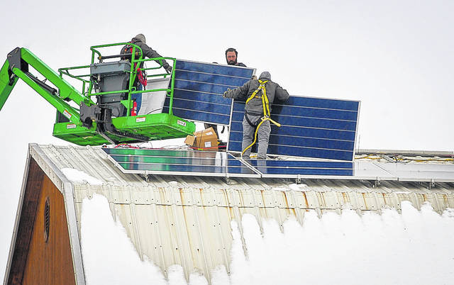 "Battling the elements to install an array of 156 solar panels on the roof of Stratford Ecological Center's barn was no easy task for a crew of technicians with Third Sun Solar from Athens. ""They had a snow blower up there to get all the snow and ice off of the buildings,"" said R. David Hoy, development director of Stratford. On Friday, the crew gained a break in the weather to start putting the panels into place on the barn and machine shed."