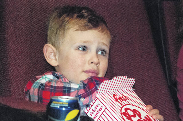 "With his eyes open as wide as they could go, Linden Smieszek, 5, munched on some popcorn as he waited for ""Peter Rabbit"" to start Monday afternoon at the Strand Theatre. He said he was happy to be there for the movie."
