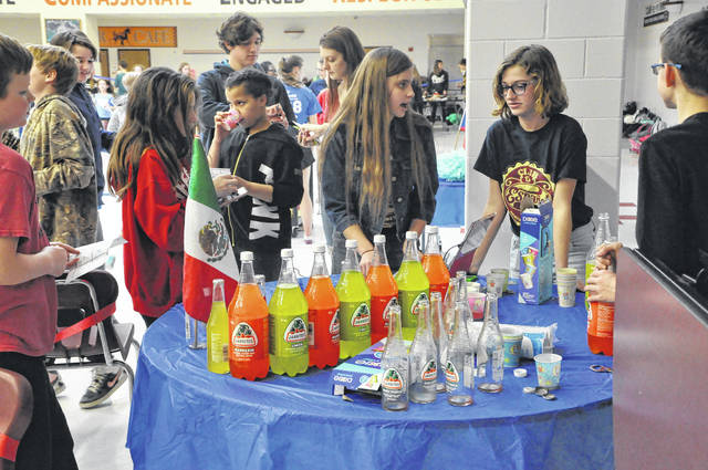 Sixth- and seventh-grade students at Dempsey Middle School sample Mexican sodas after school on Feb. 1 during the French and Spanish Festival. The soda station was one of numerous stations at the festival designed to give students a figurative and literal taste of another culture.