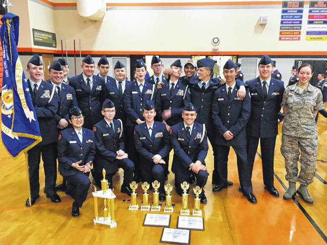 The Delaware County Air Force Junior Reserve Office Training Corps pose with the trophies it won at the 15th annual Chief Richard Halsell Memorial Drill Meet held at Hayes High School on Saturday.