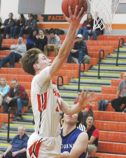 Hayes' Paul Burris soars in for an easy hoop during the first half of Tuesday's OCC showdown against visiting Worthington Kilbourne.
