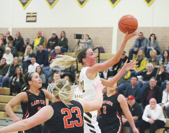 Buckeye Valley's Morgan Scowden soars toward the hoop during the first half of Friday's MOAC showdown against visiting North Union.