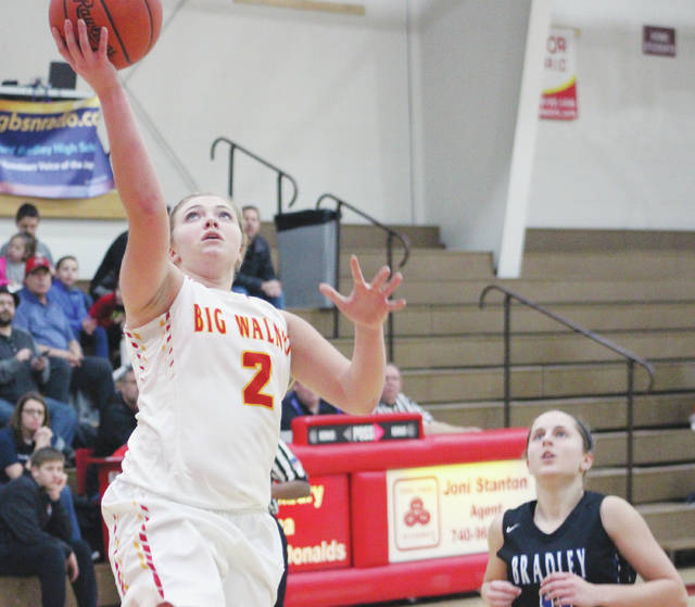 Big Walnut's Erin Boehm (2) soars to the hoop for an easy bucket during the first half of Friday's Division I District Tournament game against visiting Hilliard Bradley.
