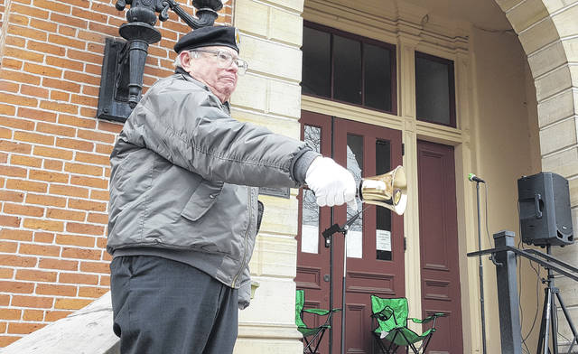 John Crouse, a U.S. Army veteran who served in Vietnam, rings a bell on the steps of the old Delaware County Courthouse in Delaware during a Vietnam War Veterans Day ceremony held Saturday in which the Vietnam Veterans of America Chapter 1095 rededicated the Vietnam memorial located in front of the courthouse. The memorial contains the names of the 10 county residents killed in action during the war. Crouse rang the bell once after each of the 10 names were read aloud.