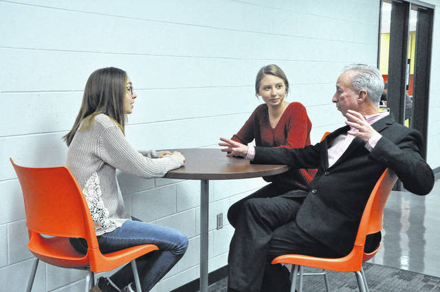 Hayes Principal Ric Stranges talks to Emma Klemanski and Hannah Elam, juniors, Friday morning about the culture at Hayes and what they think could improve.