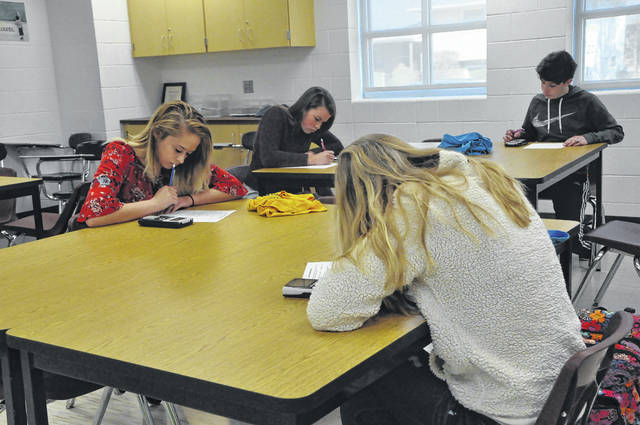 Sierra Barnhart, left, competes against Jenna Justice, right, while Max Thomas and Sydney Krewson compete at the far table. Competitors has limited time to answer as many questions as accurately as they could. Friday was the Sweet Sixteen of the competition, and the final competitions will be held next week.