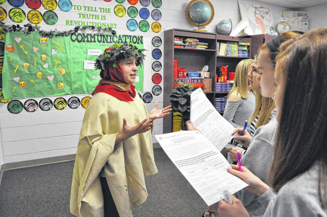 "Francesco Petrarch, played by seventh-grader Natalie Hohman, speaks to perspective voters Friday morning during The Campaign, an event that pitted numerous historical figures against each other in a race to decide the ""Ultimate Historical Difference Maker."""