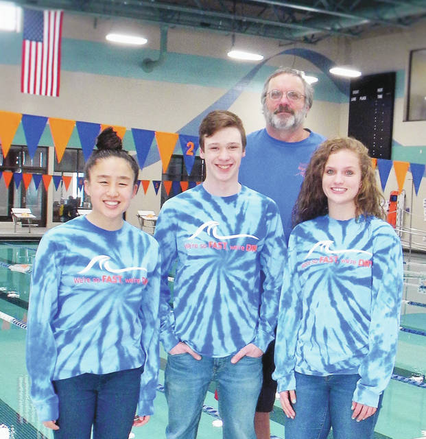 Delaware Community Center YMCA Riptide standouts Rena Ouyang, Connor Green and Mackenzie Carter (pictured from left to right with coach Axel Birnbrich) all qualified for next week's YMCA Short Course National Championship at the Greensboro Aquatic Center in Greensboro, NC.