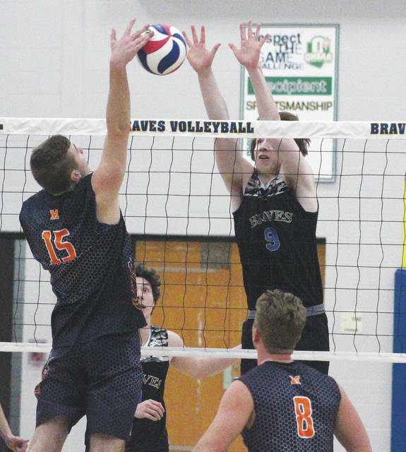 Olentangy's Mitchell Postak (9) picks up a block during the first set of Tuesday's showdown against visiting Mount Vernon.