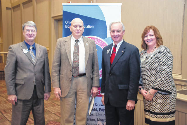 From left to right: Richard Lewis, OSBA chief executive officer (left); Ed Bischoff, DACC board member; Randy Smith, OSBA president and board member of Forest Hills Local and Amy Eyman, OSBA Central Region president and board member, Lancaster City.