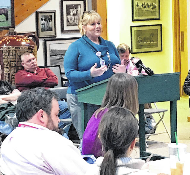 Assistant Delaware City Manager Jackie Walker describes the proposed resolution to the Delaware County Agricultural Society Board of Directors during Tuesday's meeting.
