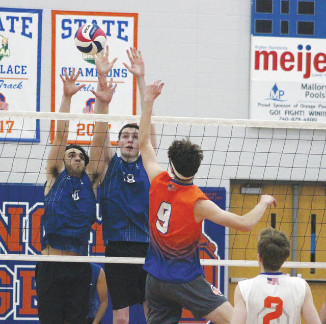 Liberty's Timmy Gies, left, and James Rogers attempt to block a shot by Orange's Mason Sears (9) during the first set of Tuesday's showdown in Lewis Center.
