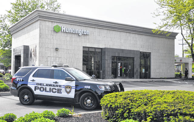 The Huntington Bank at 95 E. William St. in Delaware was robbed shortly after 4:30 p.m. Monday. According to police scanner chatter, law enforcement officers called to the scene were in search of a male suspect. The K-9 unit from the Delaware County Sheriff's Office was brought in to help with the search. Immediately following the robbery, the bank was surrounded by cruisers from the Delaware Police Department, sheriff's office and Ohio State Highway Patrol. No further information was available to The Gazette as of press time.