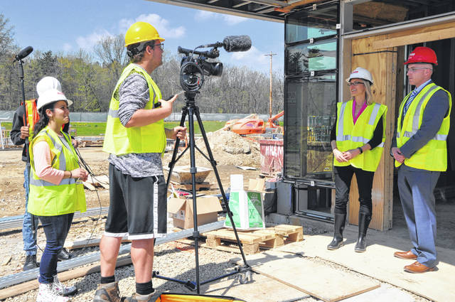 Emily Anicio directs Logan Sweeney as he begins to film a construction update with DACC Public Relations Supervisor Alicia Mowry and Pupil Services Supervisor David Gilliam. This will be the last update filmed by Anicio and her crew before the end of the school year.