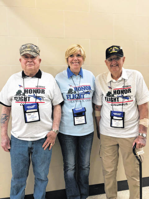 Army veterans Ken Davenport, left, and Don Wuertz, right, were accompanied by Delaware Mayor Carolyn Kay Riggle, middle, on an Honor Flight to Washington D.C. this past weekend.