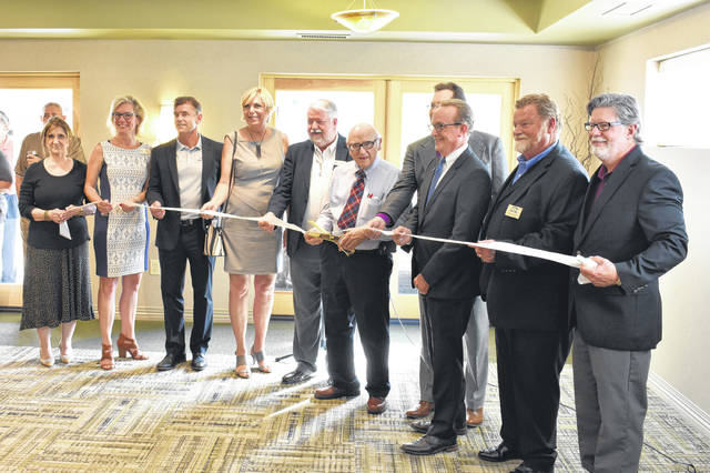 Pictured taking part in the ribbon-cutting ceremony, left to right, are Holly Quaine, Heidi Reed, Dan Rhodes, Carolyn Kay Riggle, Larry Harris, Roger Pickens, Dr. Peter Hucek, Tom Homan, Tim Burkam and Rick Brown.