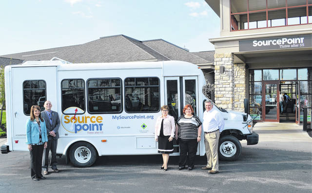 SourcePoint's new passenger bus will help bring groups of Delaware County seniors to participate in programs at its facility, 800 Cheshire Road in Delaware, and take its enrichment center members to activities throughout the state. Pictured, left to right, in front of SourcePoint and the new, wheelchair-accessible bus are Gretchen Roberts, director of nursing at OhioHealth Dublin Methodist Hospital and a member of the SourcePoint Board of Directors; Bob Horrocks, SourcePoint's executive director; Marlene Casini, president and CEO of the Delaware County Foundation; Stephanie Steinbeck, SourcePoint's community programs director; and Steve Gorman, SourcePoint's enrichment center administrator.