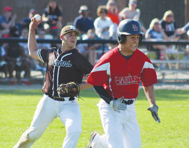 Buckeye Valley's Ben Atiyeh fires to first to retire Bishop Hartley's Frank Milliken during Thursday's Division II district tournament game in Columbus.