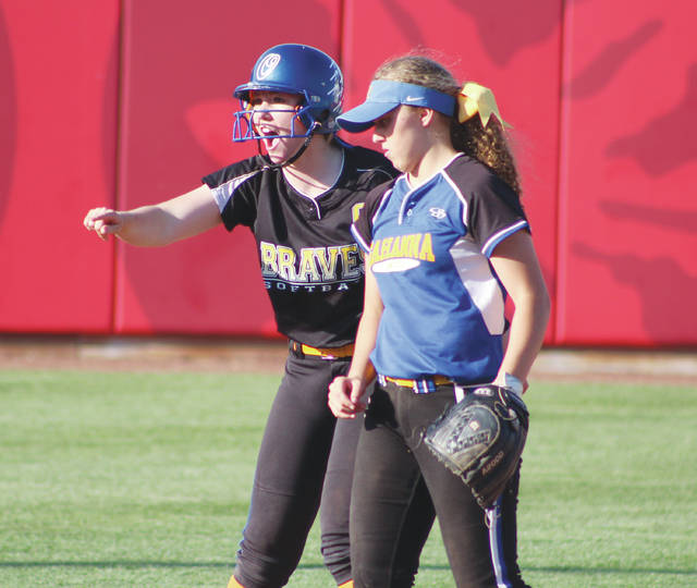 Olentangy's Kristen Kracht, left, fires up her teammates after opening the seventh inning of Wednesday's Division I regional semifinal with a lead-off double. Gahanna's Molly Troutman was covering the bag on the play.