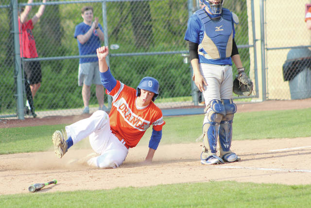 Orange's Ben Miller slides safely into home during Wednesday's Division I district tournament game against visiting Central Crossing.