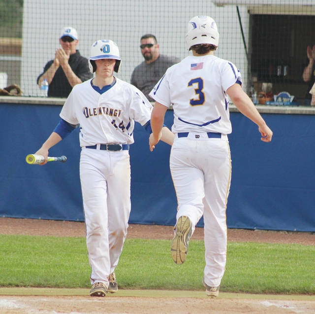 Olentangy's Lucas Hassinger congratulates Connor Haag (3) after Haag scored a run during a game earlier this season. The Braves won their second Division I district title in the last three years with a 5-4 win over Hilliard Darby Wednesday in Dublin.