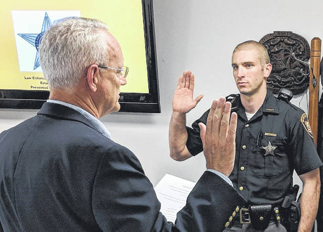 Delaware County Sheriff Russell Martin swears in new deputy Nick Ambrozich on June 18. Ambrozich has been working towards this job for the past seven years, he said and studied at the Delaware Area Career Center, OSU and interned with the DEA before being hired on at the Sheriff's Office.