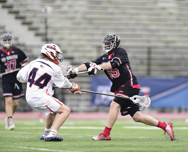 OWU senior midfielder Peter Hamblett, right, was a first-team all-region selection and was named the region's Defensive Player of the Year.
