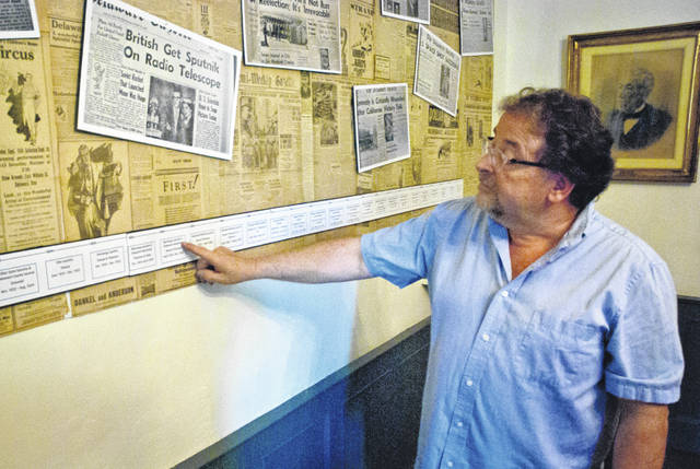 Benny Shoults, Meeker Homestead Museum curator, points to the year on the timeline that the Thompson family, longtime owners of The Delaware Gazette, became involved with the paper. Over time, the name of the paper changed many times before becoming The Delaware Gazette as it is known today.