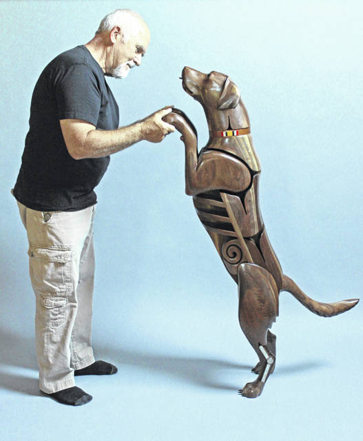 "Artist James Mellick meets his creation, Wounded Warrior Dog No. 4, ""Sniffer."""