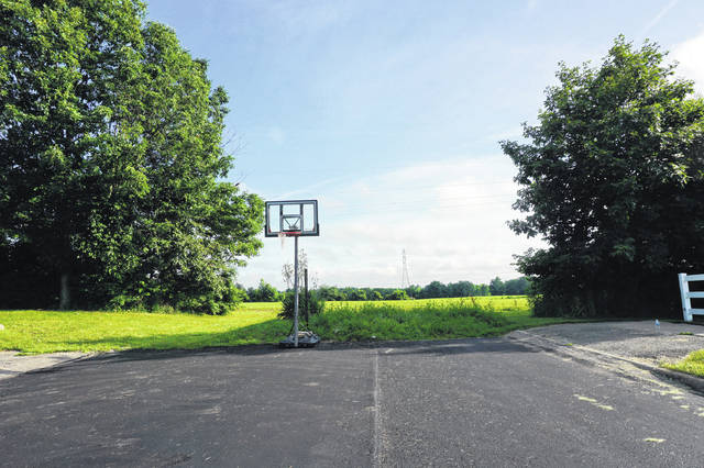 A basketball hoop currently stands at the end of Miller Drive in Sunbury. Plans are to extend the drive and construct the entrance to a high school and elementary school for Big Walnut Local Schools.