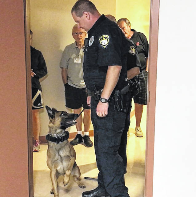 City of Delaware Police Officer Adam Graham and his partner, Ollie, visited the citizen's academy last fall where Graham demonstrated Ollie's training and ability by hiding small scented items in a large room and having Ollie locate them.